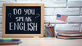 Do you speak English written on board, international flag in box, language