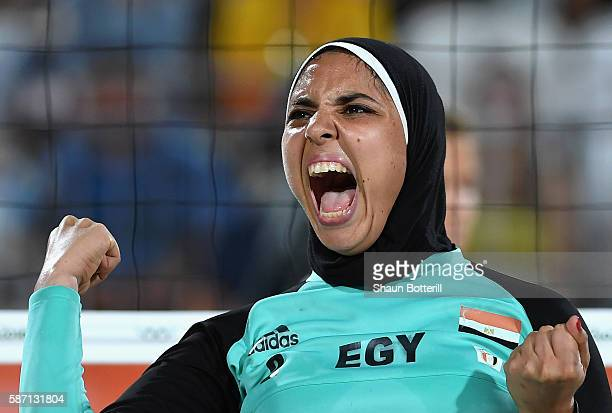 Doaa Elghobashy of Egypt reacts during the Women's Beach Volleyball preliminary round Pool D match against Laura Ludwig and Kira Walkenhorst of...