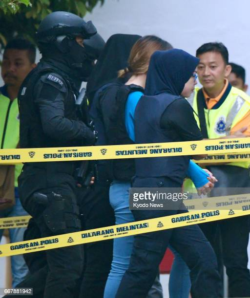 Doan Thi Huong a Vietnamese arrives at a court near Kuala Lumpur on April 13 for judicial proceedings against her and Siti Aisyah an Indonesian both...