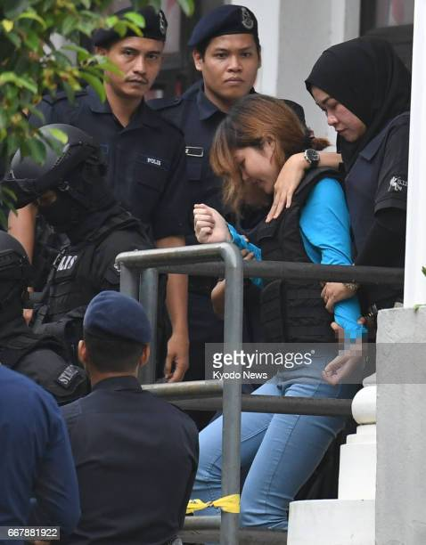 Doan Thi Huong a Vietnamese leaves a court near Kuala Lumpur on April 13 after judicial proceedings against her and Siti Aisyah an Indonesian both of...