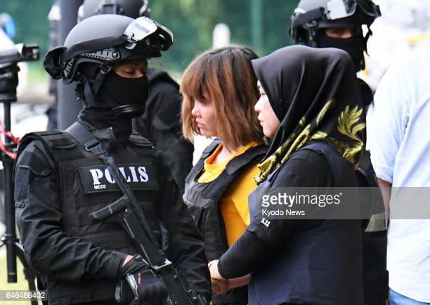 Doan Thi Huong a Vietnamese national leaves on March 1 a court in the suburbs of Kuala Lumpur where Malaysian prosecutors charged her together with...
