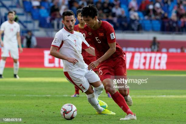 Doan Van Hau of Vietnam holds off Youseff Rawsdeh of Jordan during the AFC Asian Cup round of 16 match between Jordan and Vietnam at Al Maktoum...