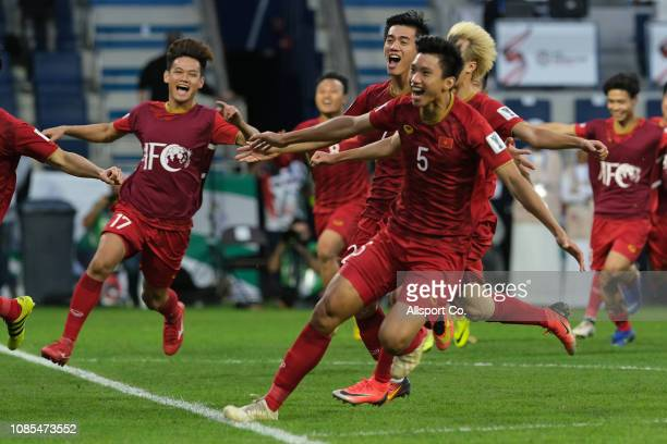 Doan Van Hau#5 of Vietnam leads his teammates in celebrattion after they defeated Jordan in a penalty shoot out during the AFC Asian Cup round of 16...