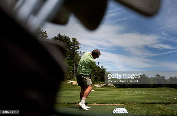 Doane Heselton, a member of the Boothbay Harbor Country Club, tees off on the driving range Wednesday, June 11, 2014. Paul Coulombe, owner of the...