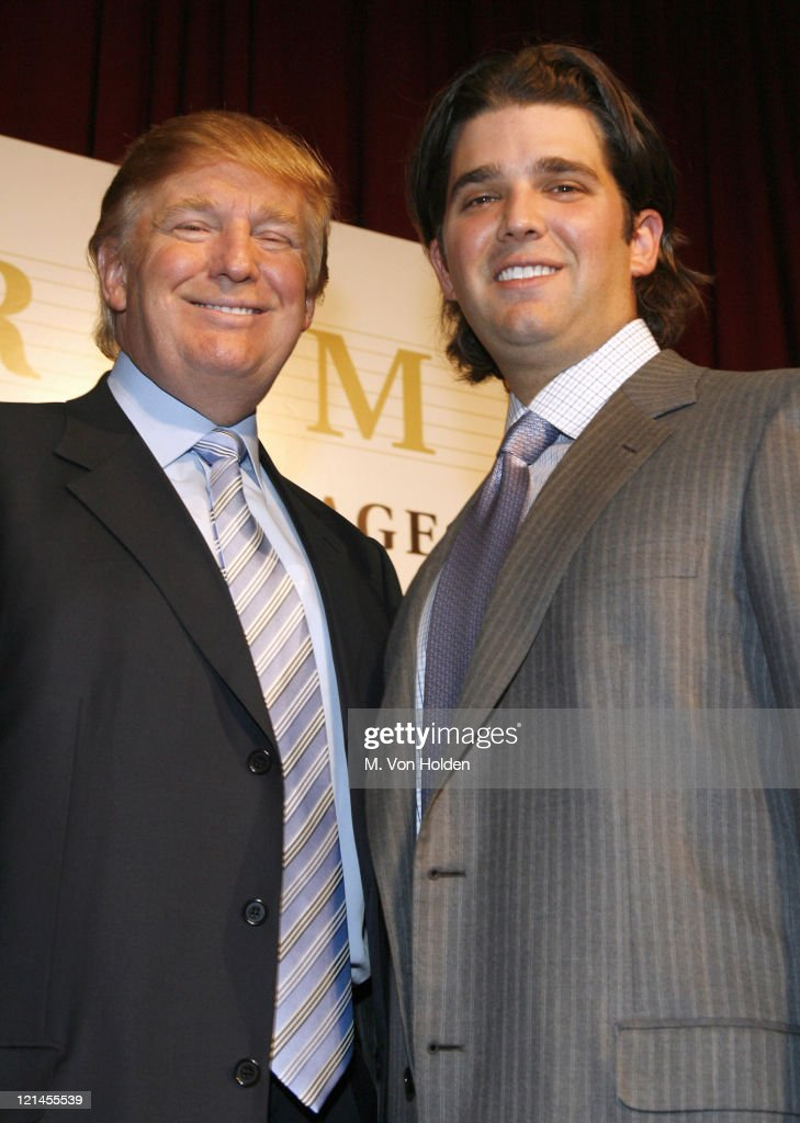 Doanld Trump and Don Trump Jr during Donald J. Trump Announces the Launch of Trump Mortgage, LLC at Trump Tower in Manhattan, New York, United States.