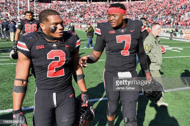 K Dobbins of the Ohio State Buckeyes and Dwayne Haskins of the Ohio State Buckeyes walk off the field after a victory over the Nebraska Cornhuskers...