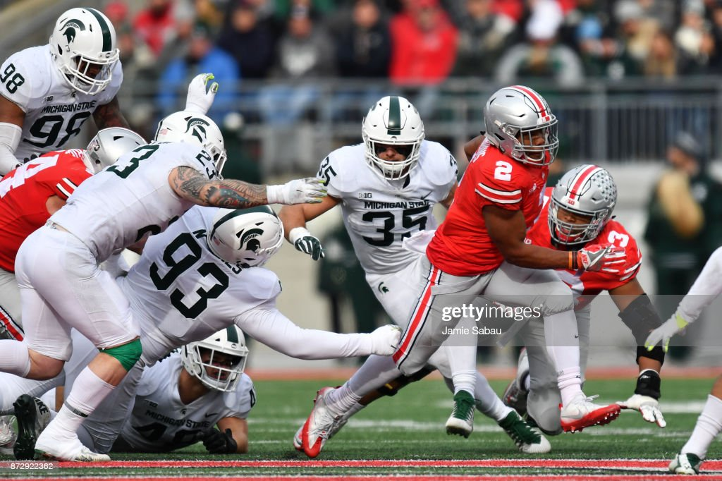 J.K. Dobbins #2 of the Ohio State Buckeyes breaks free for a first down run in the third quarter against the Michigan State Spartans at Ohio Stadium on November 11, 2017 in Columbus, Ohio. Ohio State defeated Michigan State 48-3.