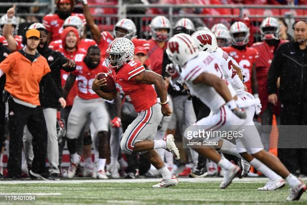 K Dobbins of the Ohio State Buckeyes breaks free from the Wisconsin Badgers defense for a 34yard run in the third quarter at Ohio Stadium on October...