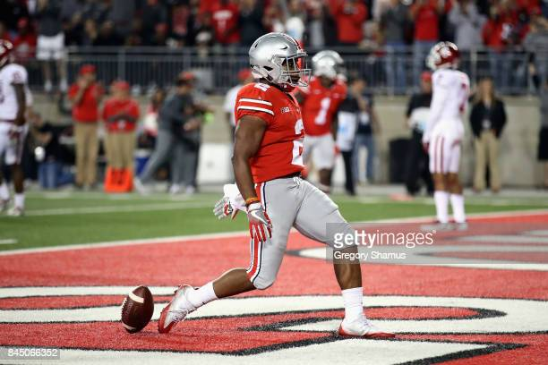 K Dobbins of the Ohio State Buckeyes celebrates scoring a 6yard rushing touchdown during the third quarter against the Oklahoma Sooners at Ohio...