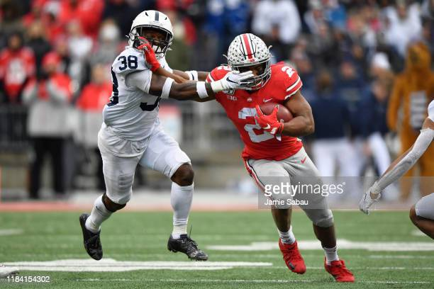 K Dobbins of the Ohio State Buckeyes fends off Lamont Wade of the Penn State Nittany Lions while picking up first down yardage in the second quarter...