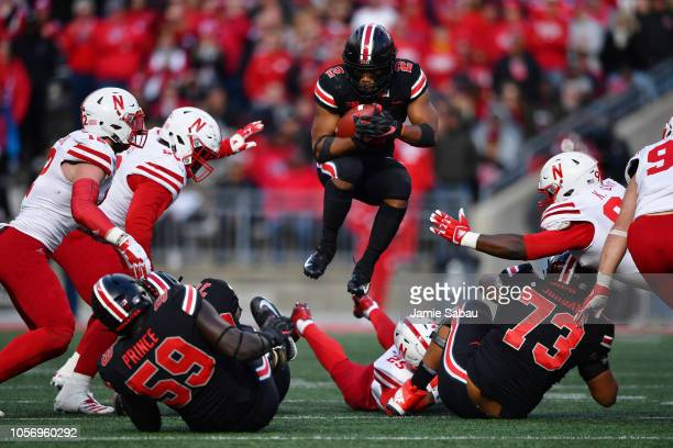 K Dobbins of the Ohio State Buckeyes leaps over blockers and would be tacklers to pick up yardage in the fourth quarter against the Nebraska...