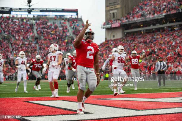 K Dobbins of the Ohio State Buckeyes reacts after scoring a touchdown during game action between the Ohio State Buckeyes and the Wisconsin Badgers on...