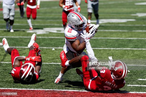 K Dobbins of the Ohio State Buckeyes runs for a touchdown during the second quarter in the game against the Indiana Hoosiers at Memorial Stadium on...