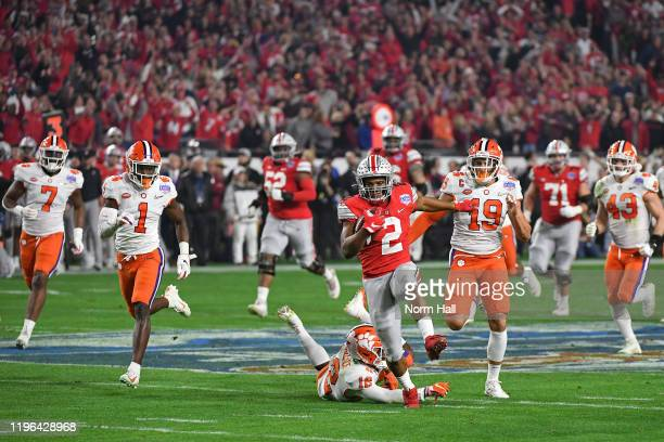 Dobbins of the Ohio State Buckeyes runs the ball against the Clemson Tigers in the first half during the College Football Playoff Semifinal at the...