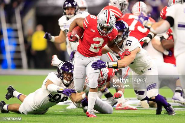 K Dobbins of the Ohio State Buckeyes runs the ball in the game against the Northwestern Wildcats in the second quarter at Lucas Oil Stadium on...