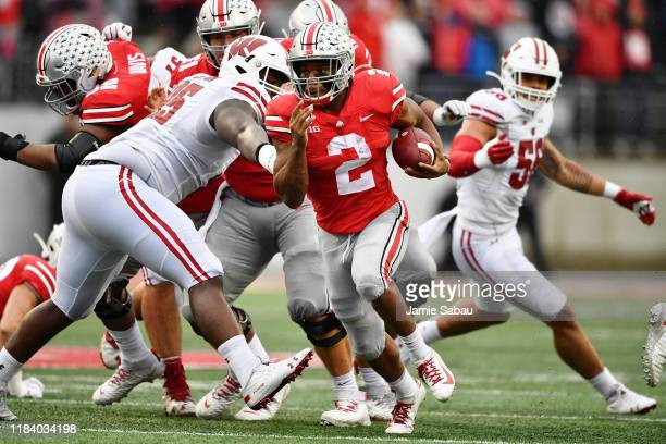 K Dobbins of the Ohio State Buckeyes runs with the ball against the Wisconsin Badgers at Ohio Stadium on October 26 2019 in Columbus Ohio