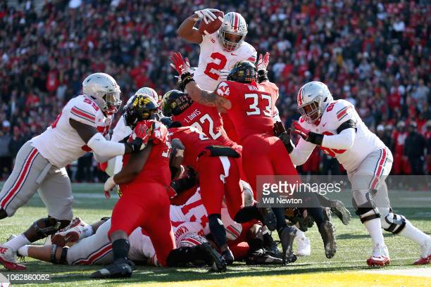 K Dobbins of the Ohio State Buckeyes scores a touchdown against the Maryland Terrapins during the first half at Capital One Field on November 17 2018...