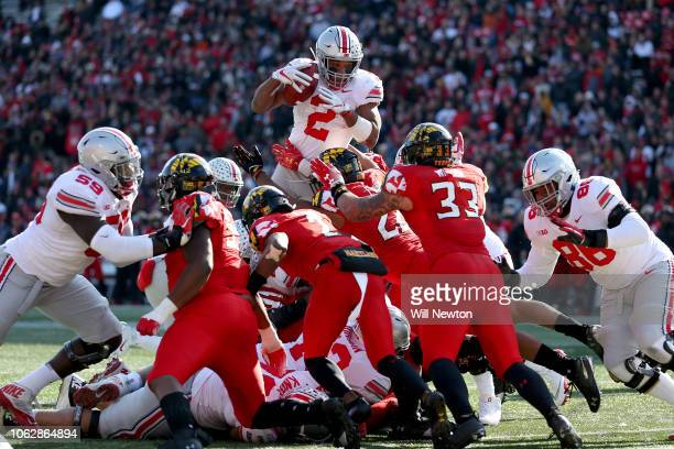Dobbins of the Ohio State Buckeyes scores a touchdown against the Maryland Terrapins during the first half at Capital One Field on November 17, 2018...