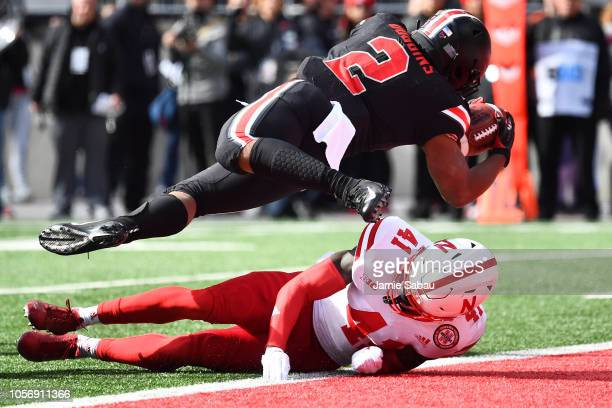 K Dobbins of the Ohio State Buckeyes scores a touchdown on a 10yard run in the first quarter over the defense of Deontai Williams of the Nebraska...