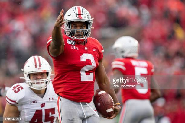 K Dobbins of the Ohio State Buckeyes signals a first down after a run during game action between the Ohio State Buckeyes and the Wisconsin Badgers on...