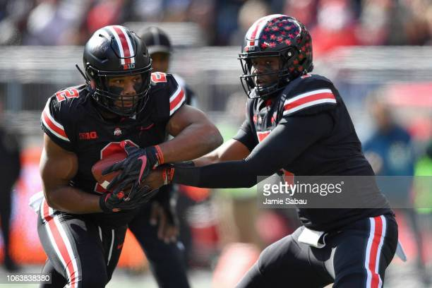 K Dobbins of the Ohio State Buckeyes takes the handoff from quarterback Dwayne Haskins of the Ohio State Buckeyes against the Nebraska Cornhuskers at...