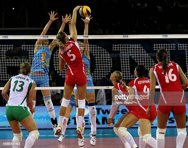 Dobriana Rabadzhieva of Bulgaria spikes the ball as her teammates look during the FIVB Women's World Championship pool F match between Bulgaria and...