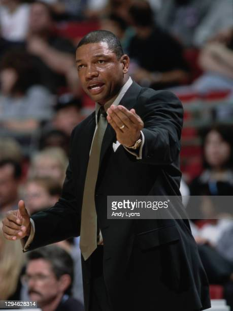 Doc Rivers, Head Coach for the Orlando Magic makes a hand signal to his players from the sideline during the NBA Atlantic Division basketball game...