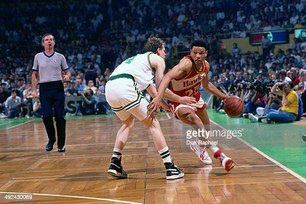 Doc Rivers of the Atlanta Hawks drives against Danny Ainge of the Boston Celtics during a game played in 1988 at the Boston Garden in Boston...
