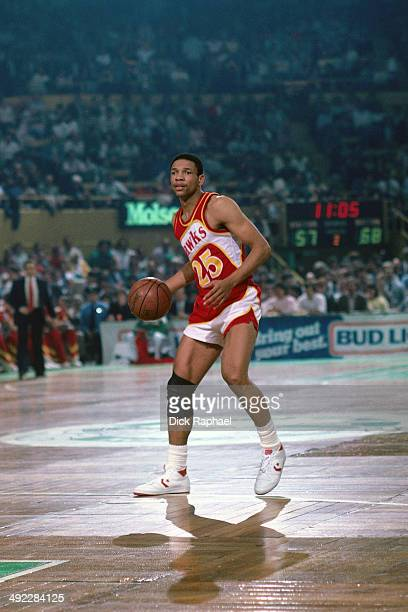 Doc Rivers of the Atlanta Hawks handles the ball against the Boston Celtics during a game circa 1986 at the Boston Garden in Boston Massachusetts...