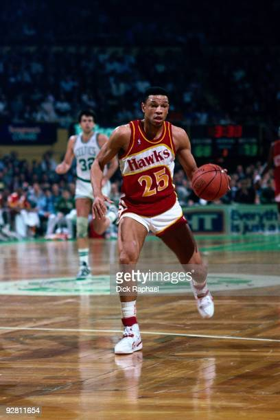 Doc Rivers of the Atlanta Hawks moves the ball up court against the Boston Celtics during a game played in 1989 at the Boston Garden in Boston...