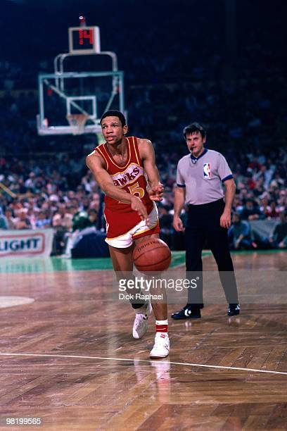 Doc Rivers of the Atlanta Hawks passes against the Boston Celtics during a game played in 1985 at the Boston Garden in Boston Massachusetts NOTE TO...