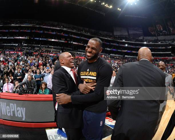 Doc Rivers of the LA Clippers and LeBron James of the Cleveland Cavaliers are seen after the game on March 18 2017 at STAPLES Center in Los Angeles...