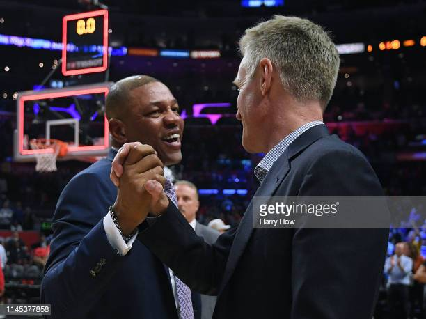 Doc Rivers of the LA Clippers and Steve Kerr of the Golden State Warriors shake hands in a 129110 Warrior win during Game Six of Round One of the...
