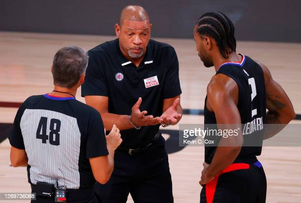 Doc Rivers of the LA Clippers argues a call with referee Scott Foster as Kawhi Leonard of the LA Clippers looks on during the first quarter in Game...