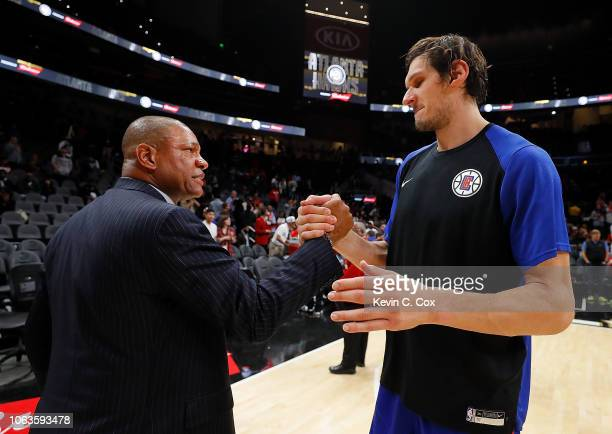 Doc Rivers of the LA Clippers shakes hands with Boban Marjanovic after their 127119 win over the Atlanta Hawks at State Farm Arena on November 19...