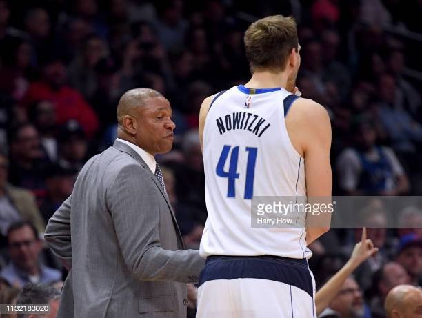 Doc Rivers of the LA Clippers shakes hands with Dirk Nowitzki of the Dallas Mavericks during the first half at Staples Center on February 25 2019 in...