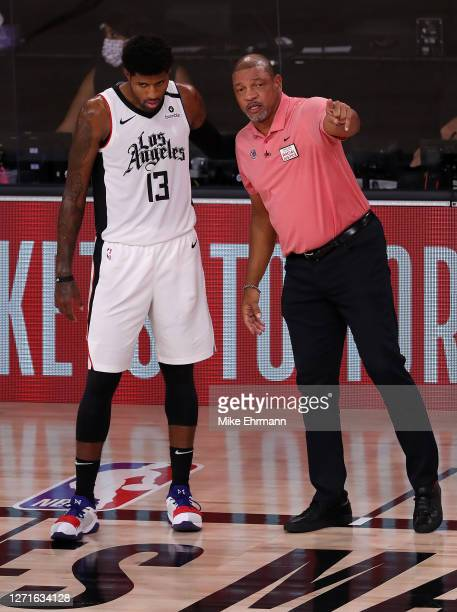 Doc Rivers of the LA Clippers talks with Paul George of the LA Clippers during the second quarter against the Denver Nuggets in Game Four of the...