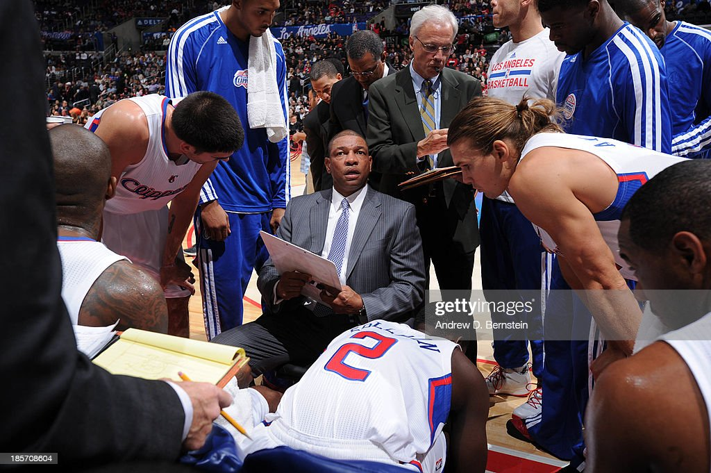 Doc Rivers of the Los Angeles Clippers directs his team in the huddle against the Utah Jazz at Staples Center on October 23, 2013 in Los Angeles, California.