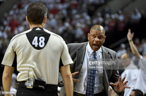 Doc Rivers of the Los Angeles Clippers has some words with referee Scott Foster in the first quarter of Game Three of the Western Conference...