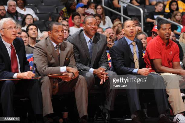 Doc Rivers of the Los Angeles Clippers sits with assistant coach Kevin Eastman Alvin Gentry Tyronn Lue and head athletic trainer Jasen Powell during...