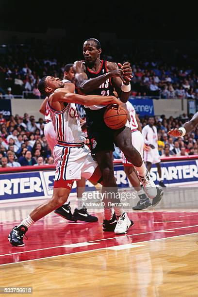 Doc Rivers of the Los Angeles Clippers steal the ball against Clyde Drexler of the Portland Trail Blazers circa 1991 at the Los Angeles Memorial...