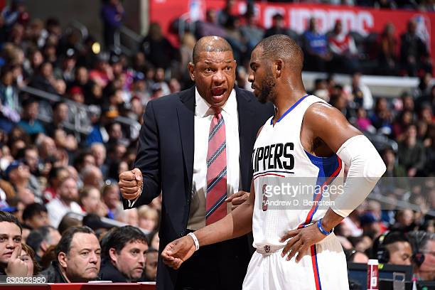 Doc Rivers of the Los Angeles Clippers talks with Chris Paul of the Los Angeles Clippers during the game against the Denver Nuggets on December 20...