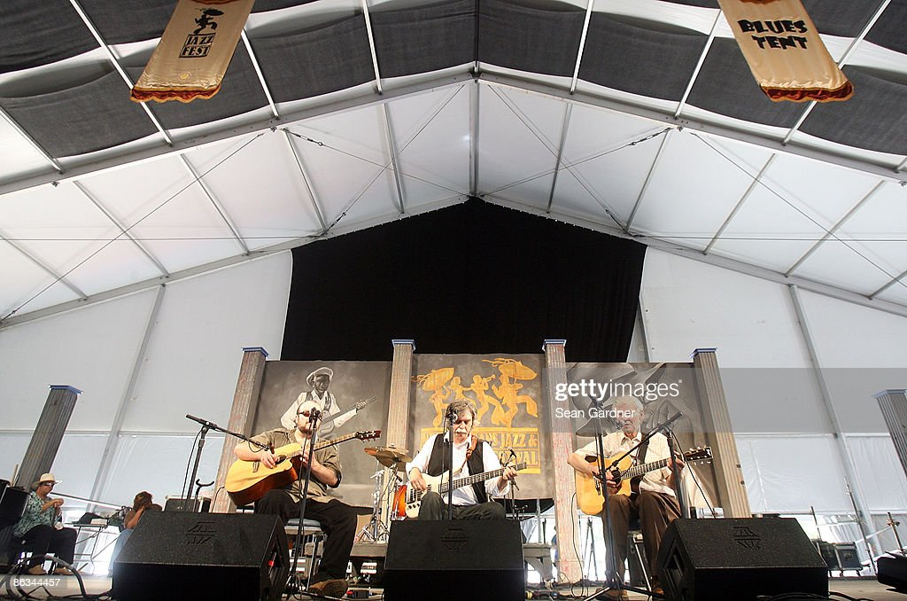 Doc Watson (R) performs during the 40th Annual New Orleans Jazz & Heritage Festival Presented by Shell at the Fair Grounds Race Course on May 1, 2009 in New Orleans.