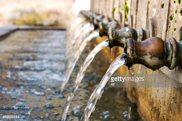 doce caños fountain in brihuega, la alcarria (spain) - spring flowing water stock pictures, royalty-free photos & images