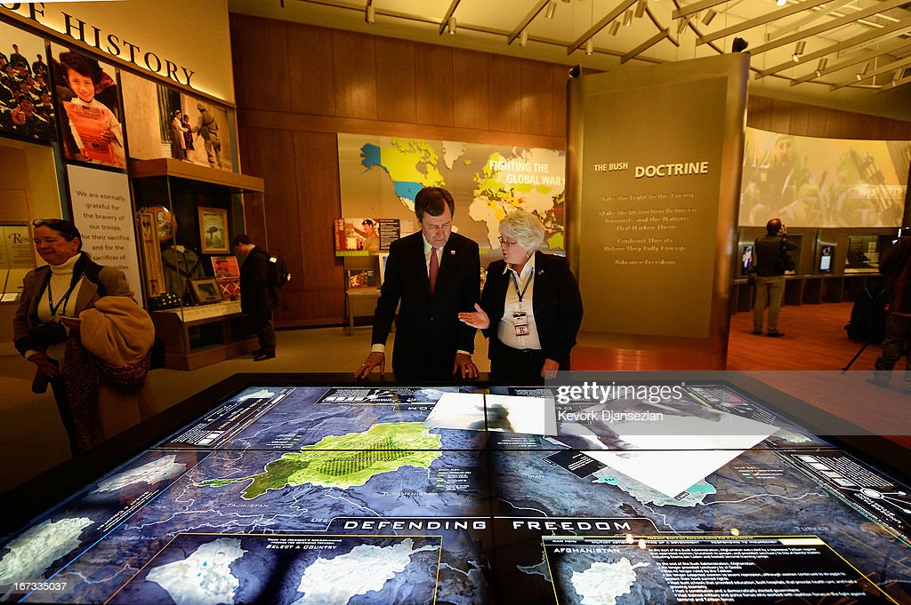 Docent Patricia Flynn shows president of Southern Methodist University R. Gerald Turner the interactive table of conflicts in the Middle East called Defending Freedom at the George W. Bush Presidential Center on the campus of Southern Methodist University on April 24, 2013 in Dallas, Texas. Dedication of the George W. Bush Presidential Library is to take place on April 25 with all five living U.S. Presidents in attendance.