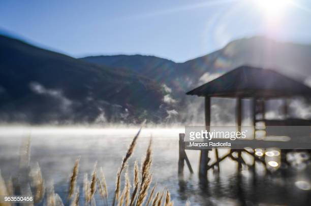 dock at dawn - radicella stock photos and pictures