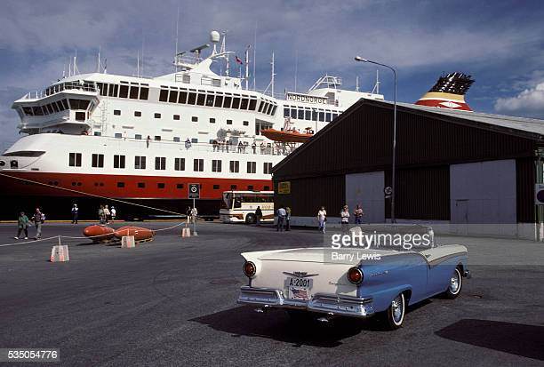 Dock at Kristiansund. The Coastal Express which sails between Bergen and Kirkenes. For more than a century, the coastal steamer Hurtigruten has been...