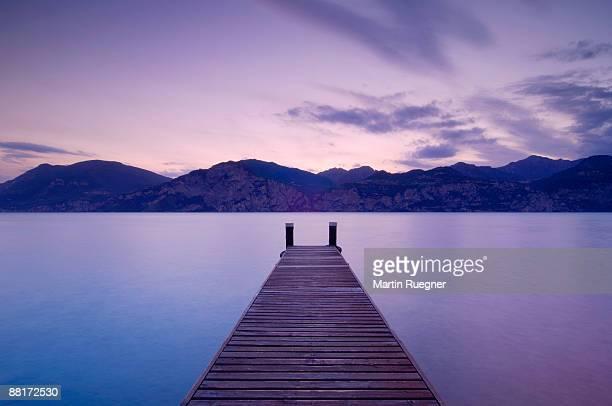 """""""dock at lake garda , italy"""" - lago di garda foto e immagini stock"""
