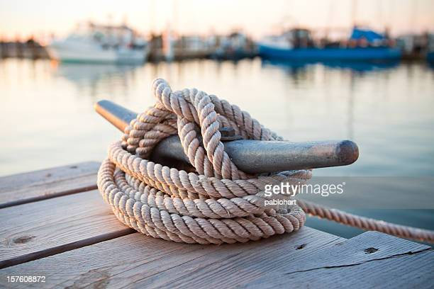 dock cleat with boats at marina - watervaartuig stockfoto's en -beelden