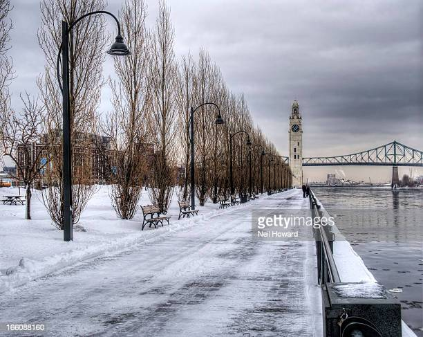 A dock, clock & bridge in snowy  Montreal